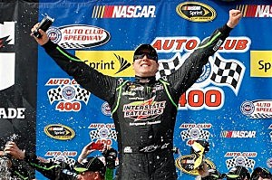 Kyle Busch celebrates in the Auto Club Speedway victory lane - March 23, 2014