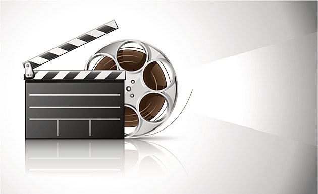 cinema clapper and video film tape on disc